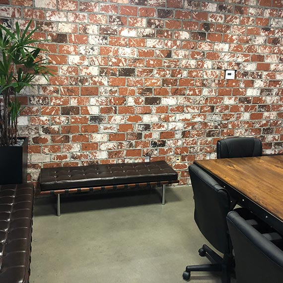 Wavelengths Office Brick Wall